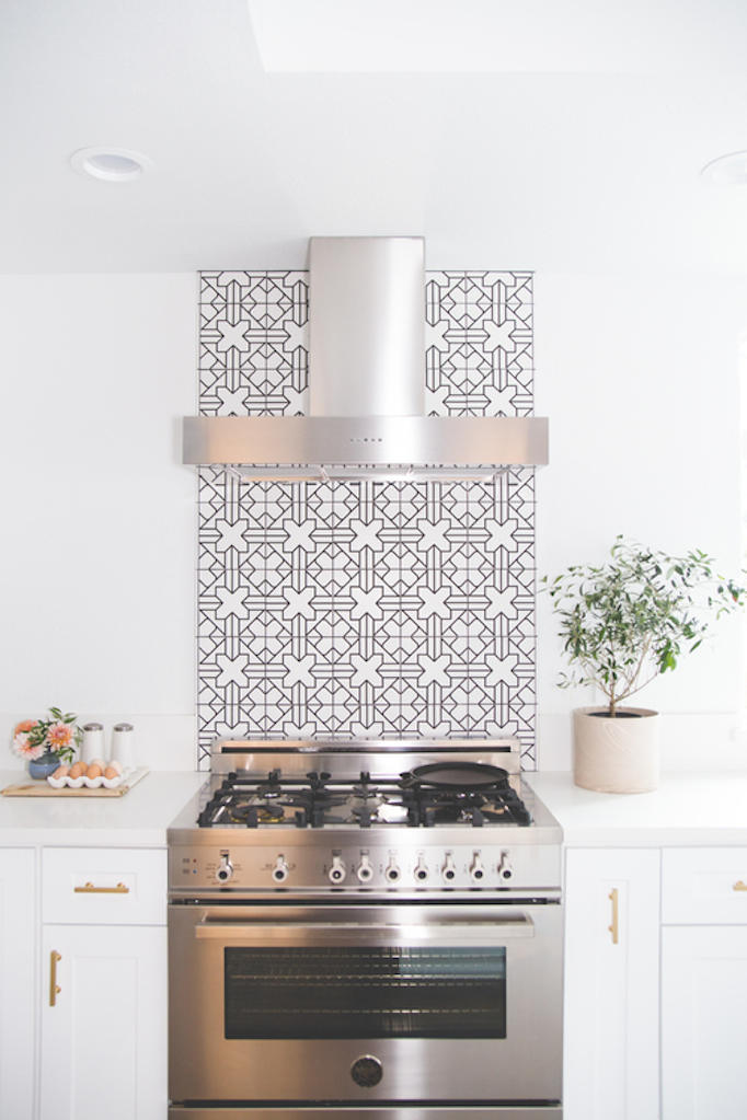steel hood patterned tile backsplash