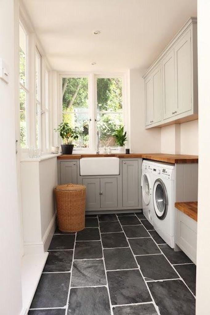 laundry room with black slate flooring