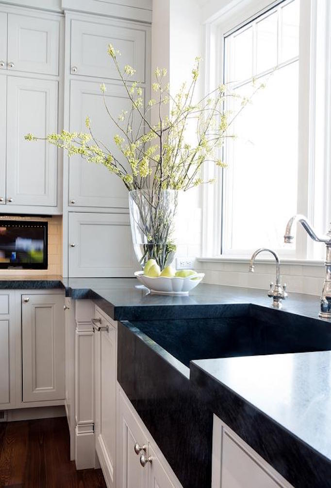 black-apron-sink-white-kitchen-cabinets-bay-window
